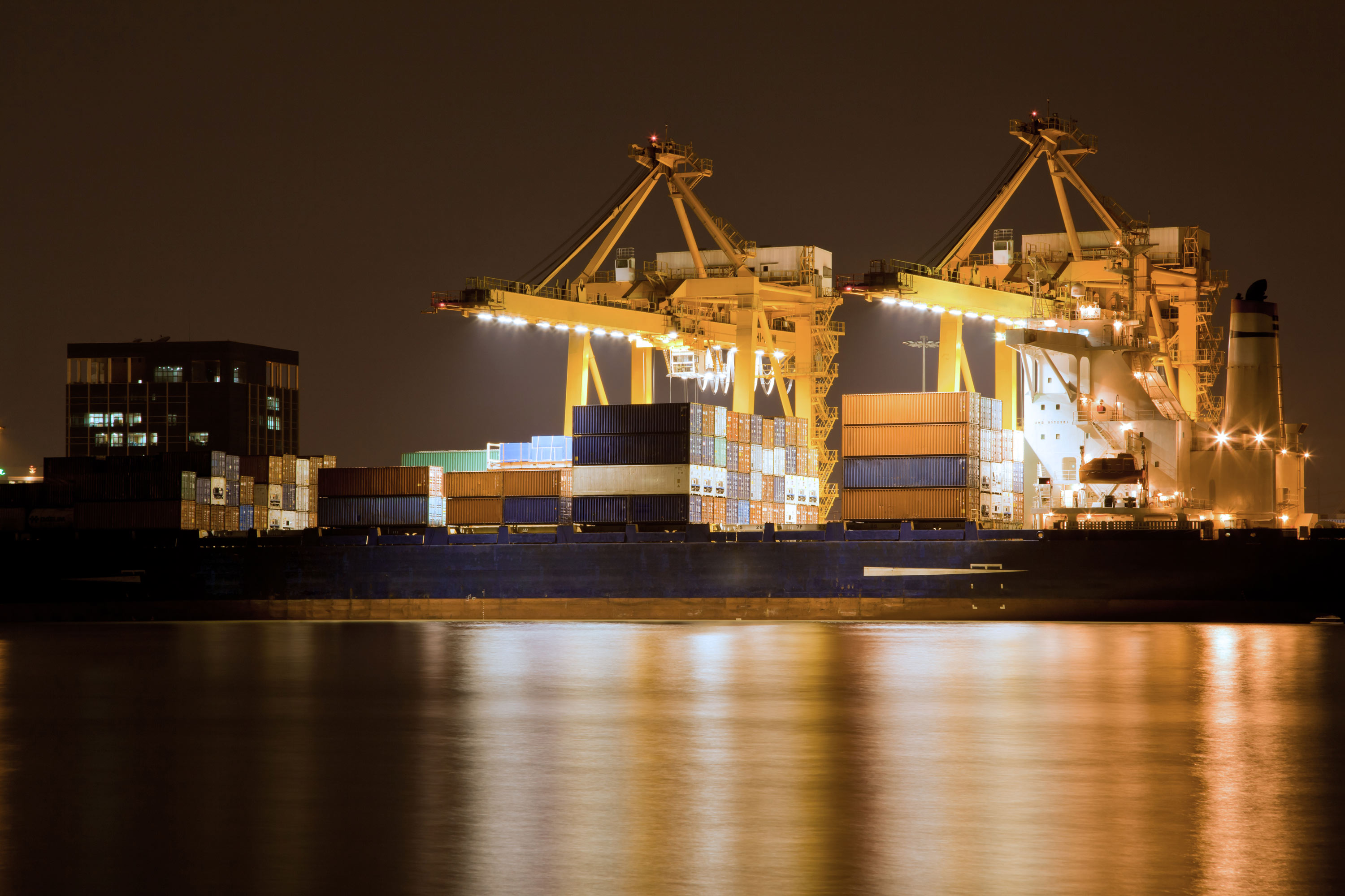 Sea freight with Tomsetts pallet distribution pictured at night.