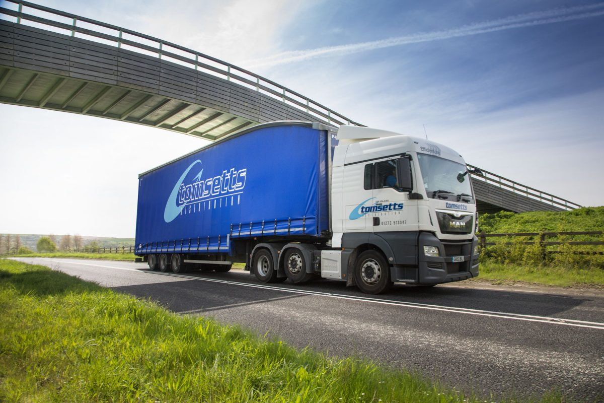 Tomsetts pallet distribution lorry drives past photographer in Newhaven, UK.